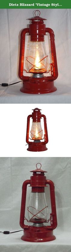 "Dietz Blizzard 'Vintage Style' Electric Lantern Table Lamp - Red. Now you can enjoy nostalgic lantern lighting anywhere! This electric lantern lamp is the largest and best selling of our modernized kerosene-to-electric lantern lamps. Electric Lantern lighting provides safe, nostalgic old fashioned lighting just about anywhere you can imagine, without the mess or smell of kerosene or oil. This lantern lamp stands right at 15"" tall (bail down) with a 8"" base and features a 7-8 foot…"
