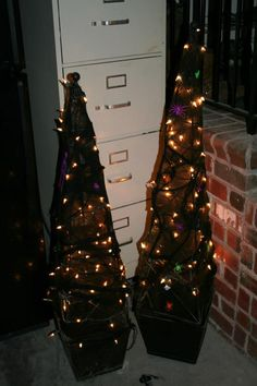 I covered wire with white lites black spider web and spiders and skeletons all from the dollar tree!