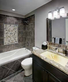 Charmant Dark Tiling And Granite Counter Tops Create A Modern Elegance In This Full  Bathroom.
