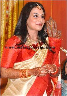 Latest Saree Designs: aishwarya rajnikanth in white and red bridal silk ...