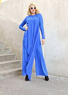 Blue extravagant jumpsuit made of the finest viscose, with a funky chiffon layer that brings both elegance and a playful touch. The fabric is so soft, that it is easy and fun to wear. Its extremely comfortable and can be worn at dinner parties or at more casual events. Material: 95% viscose, 5% elastane frontal layer: 100% chiffon  Care instructions: Wash at 30 degrees. The model in the picture is size S.  Can be made in ALL SIZES.  If you have any other specific requirements, do not…