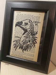 Framed page painting of a traditional tattoo style vulture on a novel from the 1960s.  mrcrypt.bigcartel.com