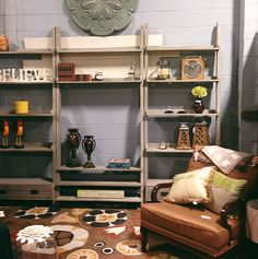 Re-staging the store a little last week. This book case and/or media storage is so shabby chic and rustic but could fit into industrial spaces as well. #decor #home #livingroom #neutral #brown www.simplyuniquefinds.com
