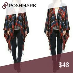 Luxurious Oversized Shawl Plaid gorgeous poncho for fall. Blanket sweater poncho in red and blue plaid. Gorgeous soft material context. Loose fit true to size. 100% acrylic. One size fits all. Small-large USA based Sizing. Made in the USA. on-trend poncho is an effortlessly stylish piece to keep on hand for a chilly office or a chic night out on the town. Fashionomics Sweaters
