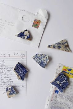 Michael Chandler made fridge magnets out of blue and white porcelain shards that he had found in and around Cape Town.