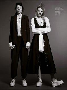 Black and white. Sneakers. Fashion magazine. Suit. Sleeveless jacket.