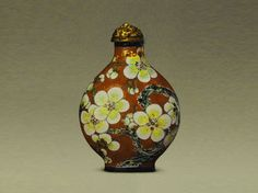Enamel Snuff Bottles of Yongzheng period (1723-1735) ~  Painted enamel snuff bottle with white plum blossom design over a purple ground  ~  Qing Dynasty
