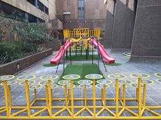 Children's playground installed in to a development in braamfontein, Johannesburg CBD, South Africa.  Querty typewriter bench seating, geodesic dome, jungle gym, slides and swings all mounted over a softened flooring covered with AstroTurf. Hand made and installed by the Create Space team.