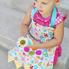 Learn how to make this sweet reversible apron for your little one! Free pattern and full picture tutorial included!