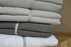 Linen bedding from Natural Bed Company in duck-egg blue, dove grey, charcoal and ivory.