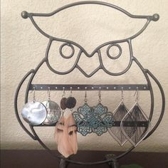 Owl Jewelry holder (jewelry included!) Cute & Adorable owl jewelry stand. Pieces of Jewelry included (see pictures) a total of 4 pairs of fun earrings. Great condition! Earrings gently used showing some signs of natural wear but overall good condition! Accessories