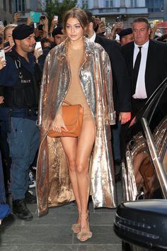 Gigi Hadid's sparkly coat left us speechless... We're glad she let it (and her killer legs) shine with simple, neutral accessories.