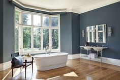Martin Brudnizki has designed a new bathroom collection for Drummonds. Shown here: the Tyburn bath, Double Ladybower vanity basin, Derwent mirror and lights drummonds-uk.com