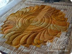NIce strategy for quilting a log cabin http://rubybluequilts.blogspot.com/