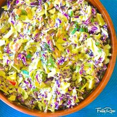 FullyRaw Sweet Rosemary Cabbage Slaw!  Purple and green cabbage, chopped bell peppers, green onion, sliced tomatoes, pineapple, and heart of palm with a dressing of blended mango, pineapple, avocado, green onion, lime, and rosemary! DIVINE!