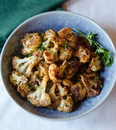 Cheesy Roasted Cauliflower - So simple! I'd probably ramp up the flavor with some chili powder and paprika. #cleaneating