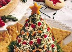 Great idea!  Christmas tree-shaped cheese ball. @Elly Kohs-at-Home/ Glenda Embree you should have Jenna do this for her next cheese ball. It's very fun.