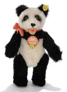A STEIFF PANDA BEAR, (5322), jointed, black and white mohair, brown and black glass eyes, black stitching, open felt mouth, script button, yellow cloth tag, chest tag and US zone tag in arm seam, circa 1952 --9in. (22cm.) high (Chi-Chi written on chest tag)