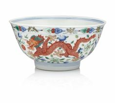 A wucai 'dragon and phoenix' bowl, Qianlong seal mark and of the period