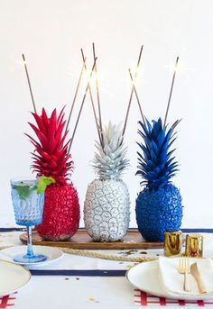Fourth of July Pineapple Sparkler Centerpieces: Have some fun with your table settings with fruity lighters, turning pineapples into playful and patriotic statement pieces. This easy DIY tutorial will make an impact!