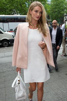 Rosie Huntington-Whiteley appeared in Berlin earlier this week in a mod A-line white shift dress casually throwing a dusty pink blazer over her shoulders.