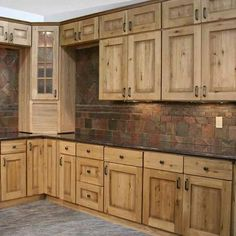 love the tile an upper cabinets  with black cabinets on bottom