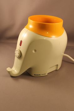 70s Classic Design Baby Food Nursing Bottle Warmer Elephant Drumbo by Luigi Colani for ROWENTA Model Bimbo West Germany by ZeitreiseFrankfurt on Etsy https://www.etsy.com/listing/212586624/70s-classic-design-baby-food-nursing