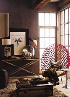 african decor...  Any time I get Lots of Brown and a Pop of Red, I get a Room I enjoy...