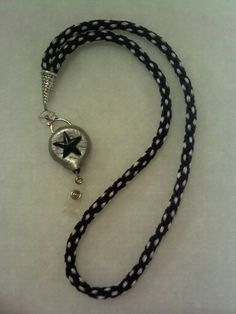 Kumihimo lanyard in Dallas Cowboy blue and silver, along with polymer clay covered badge reel holder.