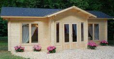Check Out This Cute Cozy Courtyard Cabin Kit for $22,000.00