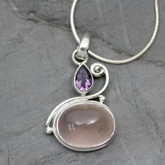 Buy Amethyst and rose quartz pendant necklace, 'Mumbai Dawn' today. Shop unique, award-winning Artisan treasures by NOVICA, the Impact Marketplace. Earrings Uk, Sterling Silver Dangle Earrings, Silver Drop Earrings, Silver Bracelets, Mumbai, Wire Jewelry Patterns, Silver Rings Online, Rose Quartz, Jewelry Gifts