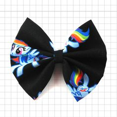 "Transform into a magical pony through this new bow in the ""Cartoon Fever"" collection. Bow is approximately 5 inches wide."