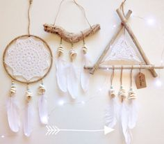 mermaid dream catcher  natural jute string wrapped metal ring with faux suede, shells, white crocheted doily, wooden beads, tibetan silver beads, large turquoise bead, wooden carved fish and white feathers attached. 41cm 16 length circle diameter 15cm 6