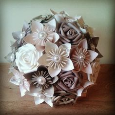 Most gorgeous alternative bouquet one of the very best paper bouquets made in UK ideal perfect bouquet for champagne taupe ivory beige theme wedding. Ultimate bridal bouquets made from paper by PaperBouquets.co,uk