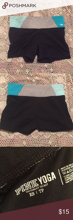 PINK yoga shorts Black yoga shorts with a Tiffany blue, teal, and gray band. Only worn two times PINK Victoria's Secret Shorts