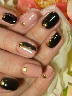 Nude and Black Nails with Gold Embellishments