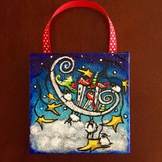 Title: Winter Dreams  One 4 x 4 Canvas Ornament with ribbon  Sides painted black, Ready to Hang  Card stock backing (not necessarily the same color