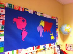 """The beginning of our """"Around the world"""" themed display  The children copied flags from a poster for the border. We are focusing on a different part of the world each week and adding art work, facts etc relating to that country/continent!"""