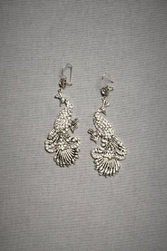 Pave Marvel Earrings. French wire. Swarovski crystals, silver plated metal.