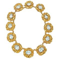 """Georgian Gold & Aquamarine Link Necklace  Georgian aquamarine link necklace, designed as a sequence of foliate scroll-motif yellow gold links each centering on an oval-shaped aquamarine measuring approximately 17mm in length and 12-14mm in width, the twelve aquamarines weighing approximately 100 total carats. 16.5"""" length and 1.25"""" approximate width at widest point of each link."""