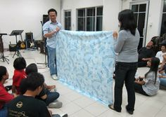 The Blanket Game is a funny icebreaker to get to know other folks in the room. A large blanket is held up between two groups, and one player from each team stands behind the blanket. The goal of the game is to be the first to identify the other person behind the blanket. Materials required: [...]Continue reading...