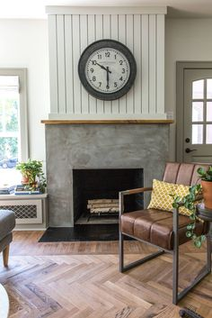 The flip house fireplace was stucco painted to look like concrete! Why not real concrete? Stucco isn't near as heavy. This technique, combined with vertical shiplap, gave this room personality.