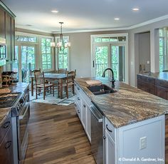 This open floor plan lets so much natural light into the #kitchen. The Butler Ridge #1320-D. http://www.dongardner.com/house-plan/1320-D/the-butler-ridge. #OpenConcept #FloorPlan