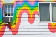 The psychedelic artwork adorning the Surf Lodge's exterior was painted by the artist Jen Stark.