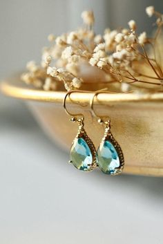 Faceted blue crystal dangly earrings that would go great with any get-up