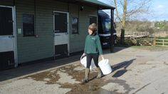 Jess from The Horse Trust putting OiPPS buckets to use!