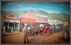 Mural, painted by the artist Robert Dafford,  at the Miners Alley Playhouse, formerly the site of the Foss Drug Co. (estb. 1913) in Golden, Colorado. Heinie Foss is pictured on a bicycle on the left.