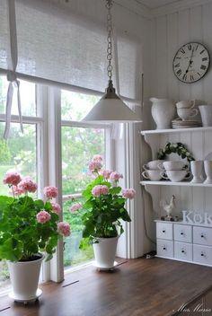 Shabby Chic kitchen with dark wood counter, white accessories.