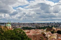 Vltava river, Charles bridge, clouds, bubbles and the streets of Prague