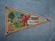 Check out this item in my Etsy shop https://www.etsy.com/uk/listing/528769116/vintage-travel-pennant-a-souvenir-flag